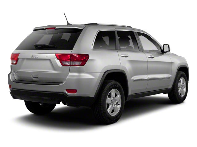 2013 Jeep Grand Cherokee Prices and Values Utility 4D Overland 4WD side rear view
