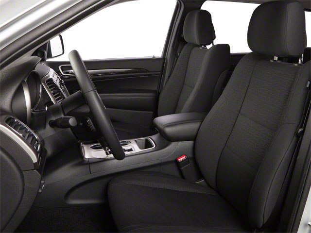 2013 Jeep Grand Cherokee Prices and Values Utility 4D Overland 4WD front seat interior
