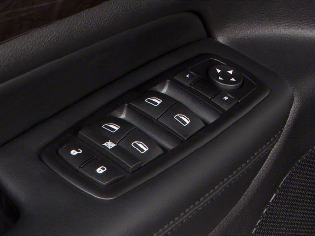 2013 Jeep Grand Cherokee Prices and Values Utility 4D Overland 4WD driver's side interior controls