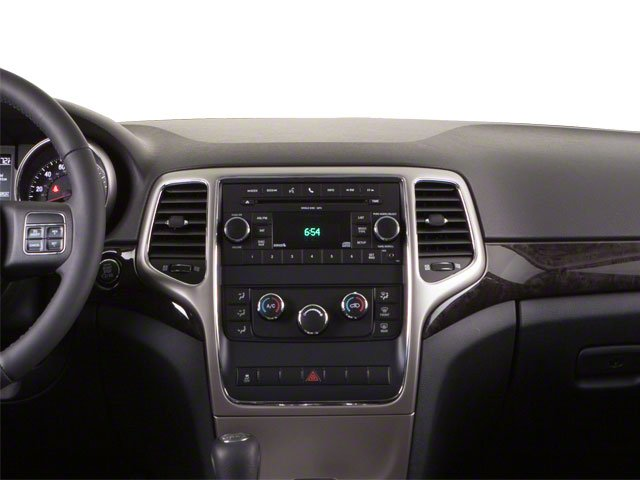 2013 Jeep Grand Cherokee Prices and Values Utility 4D Overland 4WD center dashboard