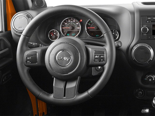 2013 Jeep Wrangler Prices and Values Utility 2D Sahara 4WD driver's dashboard