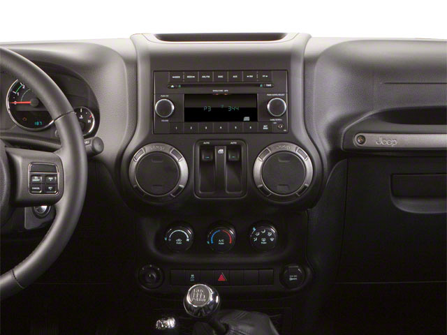 2013 Jeep Wrangler Prices and Values Utility 2D Rubicon 4WD center dashboard