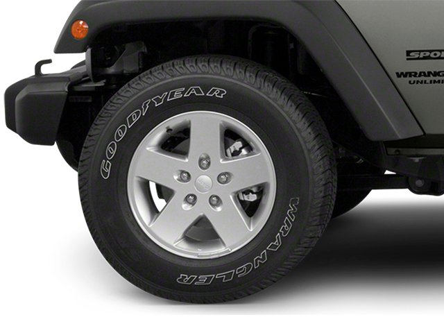 2013 Jeep Wrangler Unlimited Pictures Wrangler Unlimited Utility 4D Unlimited Sahara 4WD photos wheel