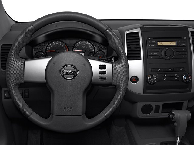 2013 Nissan Frontier Prices and Values Crew Cab SV 4WD driver's dashboard