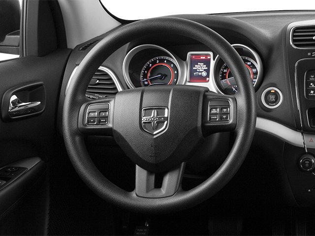 2014 Dodge Journey Prices and Values Utility 4D SXT AWD driver's dashboard
