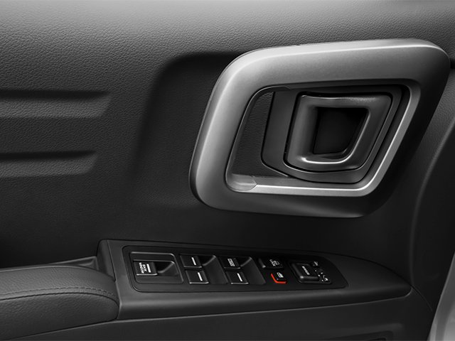 2014 Honda Ridgeline Prices and Values Utility 4D SE 4WD driver's side interior controls