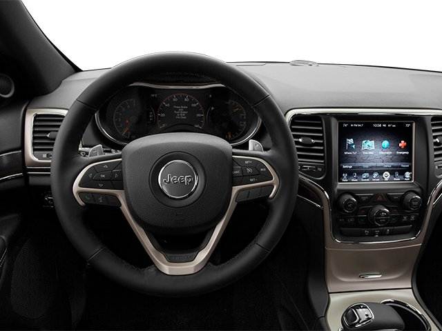 2014 Jeep Grand Cherokee Prices and Values Utility 4D Overland Diesel 4WD driver's dashboard