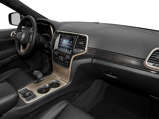 2014 Jeep Grand Cherokee Prices and Values Utility 4D Overland Diesel 4WD passenger's dashboard