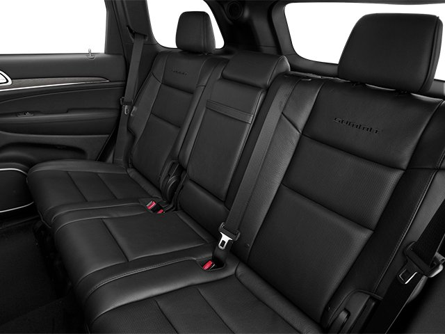 2014 Jeep Grand Cherokee Prices and Values Utility 4D Summit 4WD backseat interior