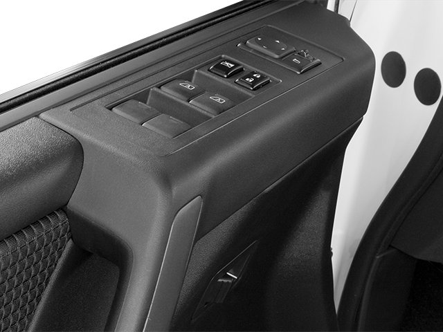 2014 Nissan Titan Prices and Values Crew Cab SV 4WD driver's side interior controls