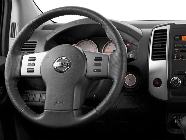 2014 Nissan Xterra Prices and Values Utility 4D S 2WD driver's dashboard