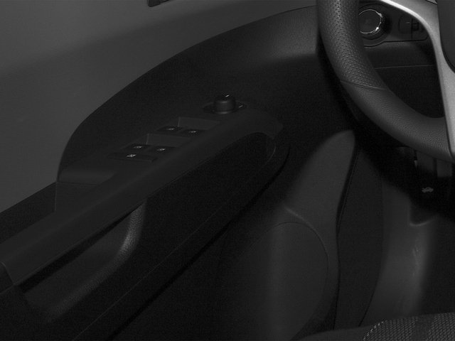 2015 Chevrolet Sonic Prices and Values Sedan 4D LS I4 driver's side interior controls