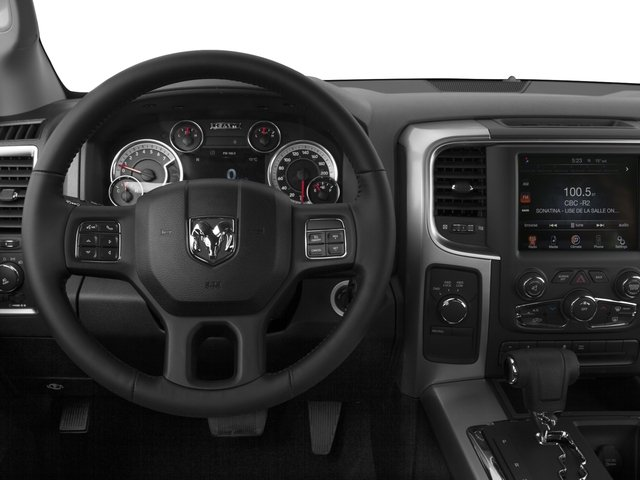 2015 Ram Truck 1500 Pictures 1500 Quad Cab SLT 4WD photos driver's dashboard