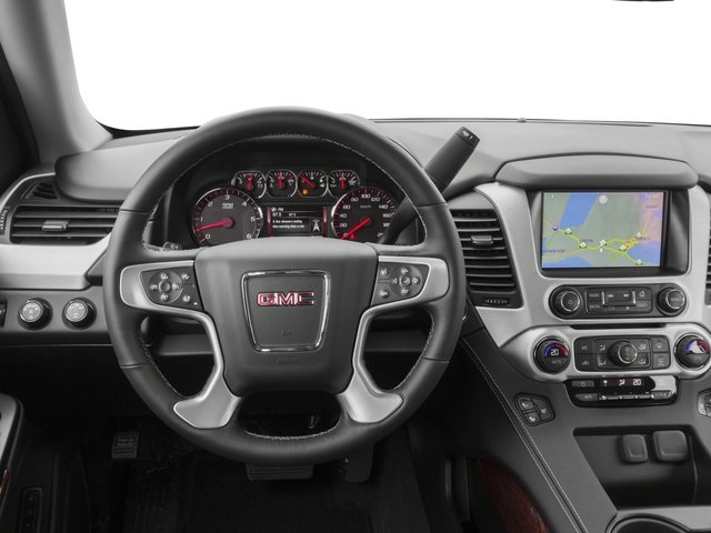 2015 GMC Yukon Prices and Values Utility 4D SLT 2WD driver's dashboard