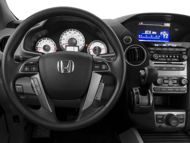 2015 Honda Pilot Prices and Values Utility 4D SE 2WD V6 driver's dashboard