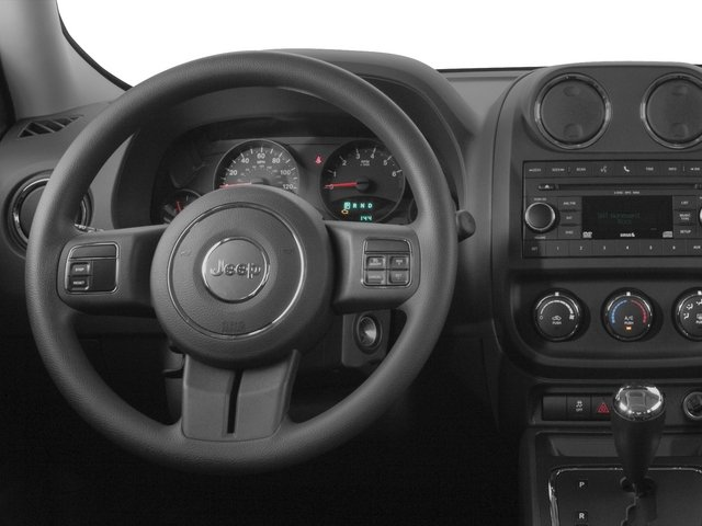 2015 Jeep Patriot Prices and Values Utility 4D Latitude 4WD driver's dashboard