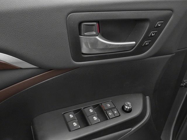 2015 Toyota Highlander Prices and Values Utility 4D LE Plus 4WD V6 driver's side interior controls