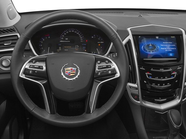 2016 Cadillac SRX Prices and Values Utility 4D Luxury 2WD V6 driver's dashboard