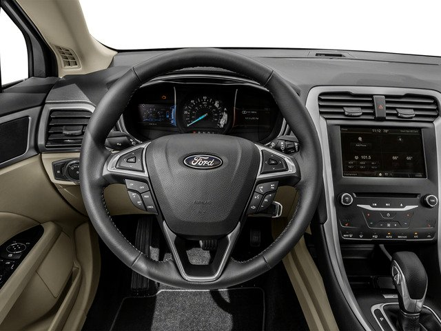 2016 Ford Fusion Prices and Values Sedan 4D Titanium I4 Hybrid driver's dashboard