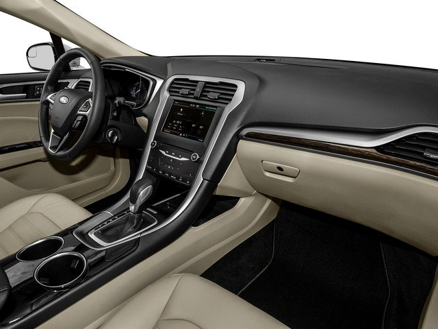 2016 Ford Fusion Prices and Values Sedan 4D Titanium I4 Hybrid passenger's dashboard
