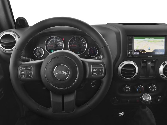 2016 Jeep Wrangler Prices and Values Utility 2D Sahara 4WD V6 driver's dashboard