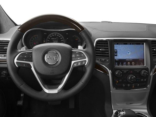 2016 Jeep Grand Cherokee Prices and Values Utility 4D Summit 4WD driver's dashboard