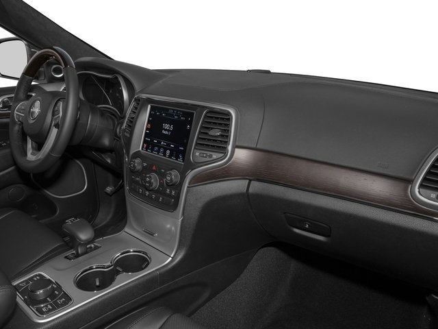 2016 Jeep Grand Cherokee Prices and Values Utility 4D Summit 4WD passenger's dashboard