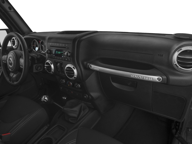 2016 Jeep Wrangler Unlimited Prices and Values Utility 4D Unlimited Sahara 4WD V6 passenger's dashboard