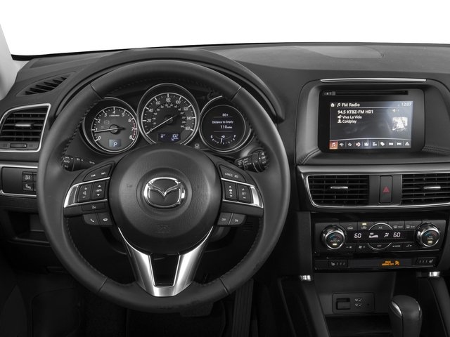 2016 Mazda CX-5 Prices and Values Utility 4D GT AWD I4 driver's dashboard