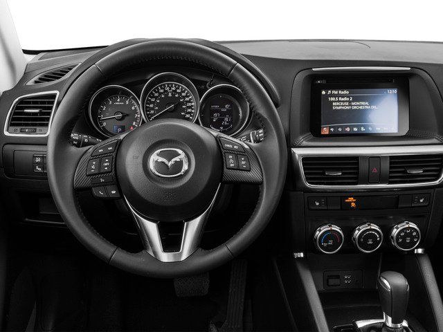 2016 Mazda CX-5 Prices and Values Utility 4D Touring 2WD I4 driver's dashboard