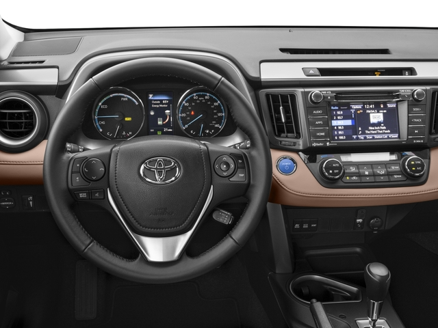 2016 Toyota RAV4 Hybrid Prices and Values Utility 4D XLE AWD I4 Hybrid driver's dashboard