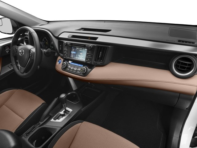 2016 Toyota RAV4 Hybrid Prices and Values Utility 4D XLE AWD I4 Hybrid passenger's dashboard