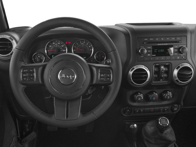 2017 Jeep Wrangler Unlimited Prices and Values Utility 4D Unlimited Sahara 4WD V6 driver's dashboard
