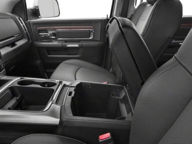 2017 Ram Truck 3500 Pictures 3500 Laramie Longhorn 4x2 Mega Cab 6'4 Box photos center storage console