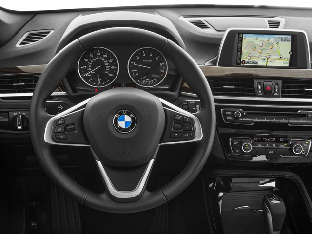 2018 BMW X1 Base Price xDrive28i Sports Activity Vehicle Pricing driver's dashboard