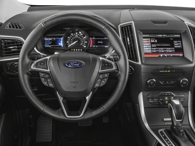 2018 Ford Edge Prices and Values Utility 4D Titanium AWD I4 Turbo driver's dashboard