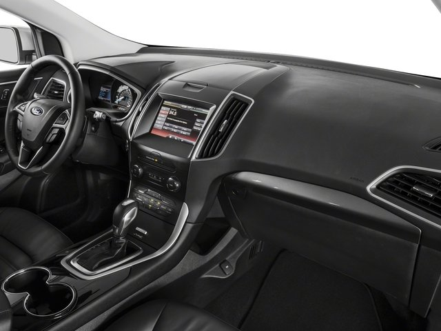 2018 Ford Edge Prices and Values Utility 4D Titanium AWD I4 Turbo passenger's dashboard
