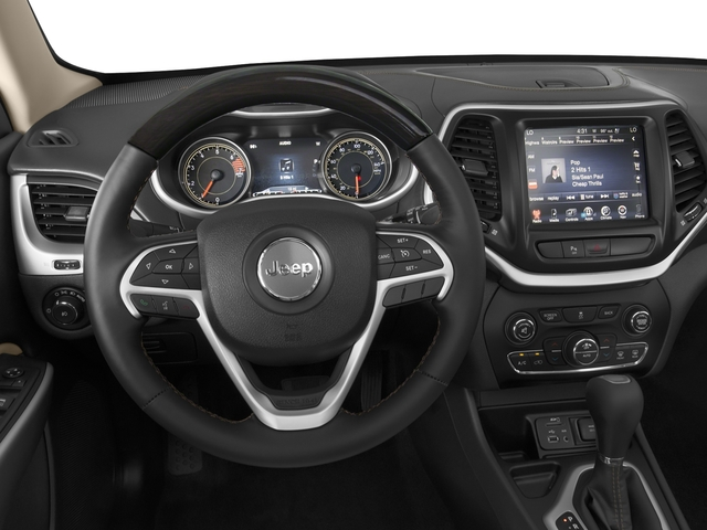 2018 Jeep Cherokee Base Price Overland 4x4 Pricing driver's dashboard