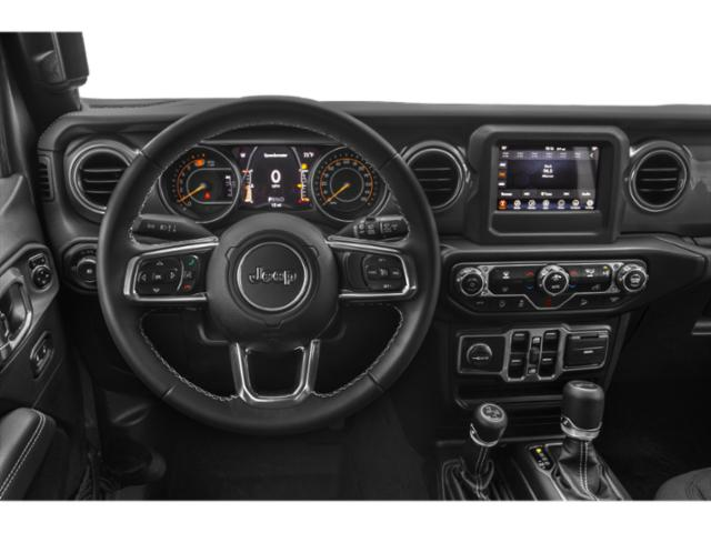 2018 Jeep Wrangler Unlimited Prices and Values Utility 4D Sahara 4WD V6 driver's dashboard