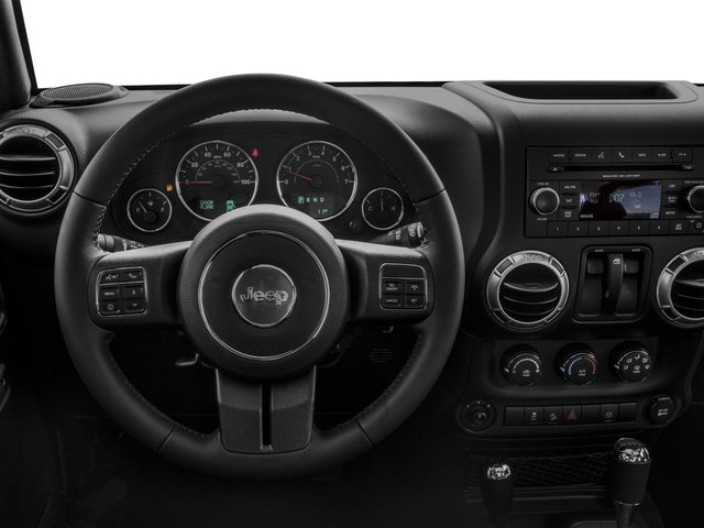 2018 Jeep Wrangler JK Prices and Values Utility 2D Sahara 4WD driver's dashboard