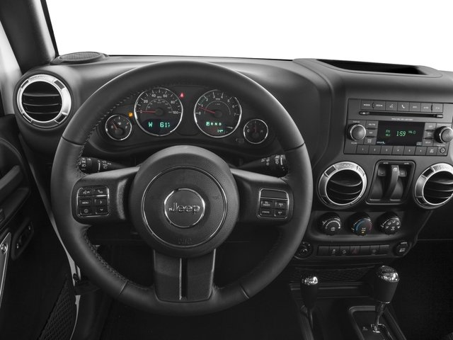 2018 Jeep Wrangler JK Base Price Rubicon 4x4 Pricing driver's dashboard