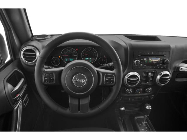 2018 Jeep Wrangler JK Unlimited Prices and Values Utility 4D Unlimited Sport 4WD driver's dashboard