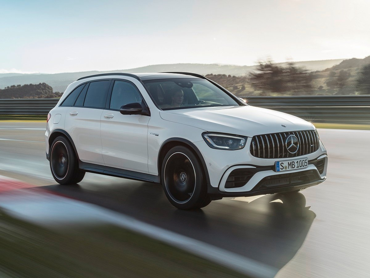 2022 Mercedes-AMG GLC 63 S SUV White Front Quarter View in Motion
