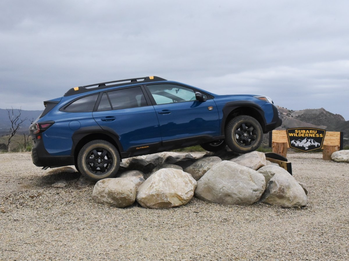 2022 Subaru Outback Wilderness Geyser Blue Side View Parked on Rocks