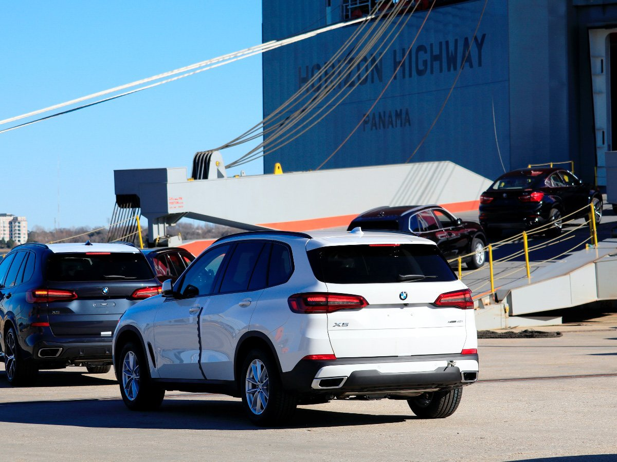 BMWs made in America being loaded onto a ship for export