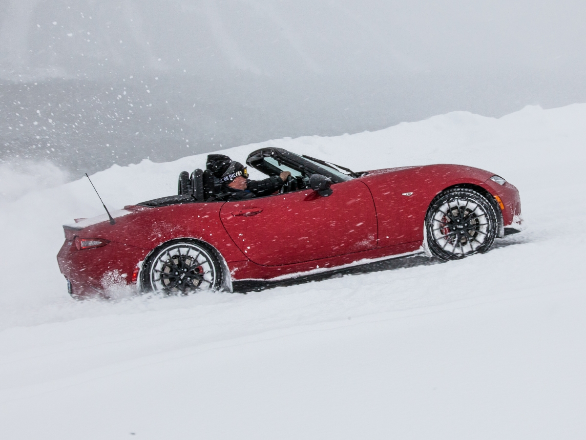 Mazda Miata Driving in Snow Top Down Red Side View