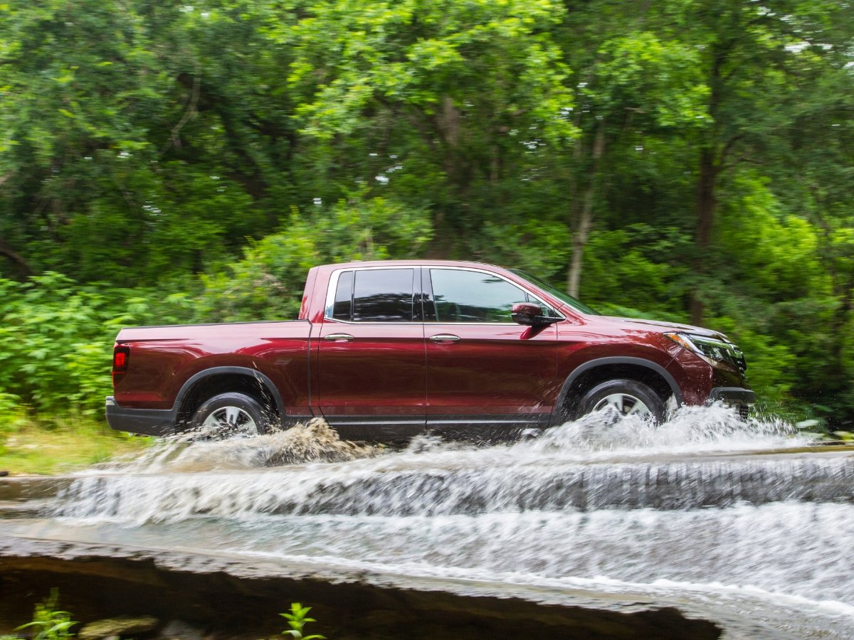 Midsize Crew Cab Pickup Truck Driving Through Water