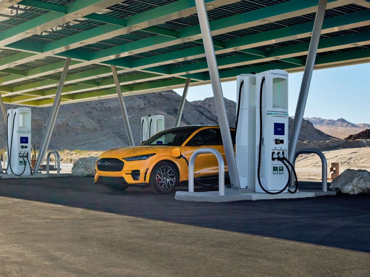 Yellow Ford Mustang Mach-E Charging at Electrify America DC Fast Charger