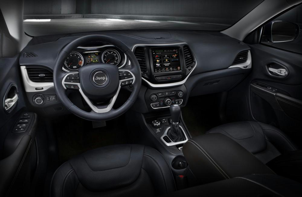 The Cherokeeu0027s Front Passenger Seat Folds In Half To Help The SUV Carry  Longer Items, And The Rear Seat Provides 6 Inches Of Fore/aft Travel And A  ...