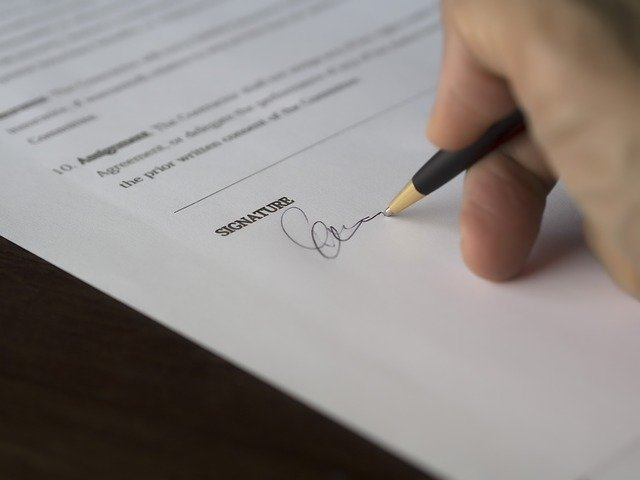 How To Sign Over a Car Title